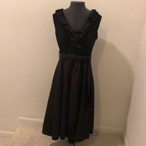 Long black dress with ruffled v-neck collar